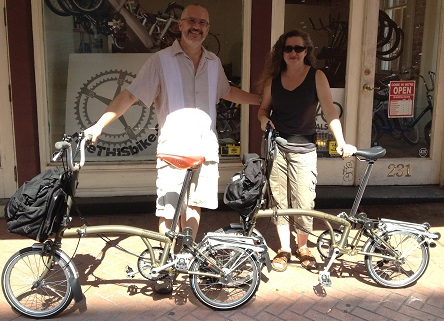 2 customers leaving our bike shop with their new Brompton folding bikes