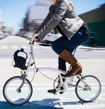 Riding a Brompton bike fitted with a removeable, purse sized bag