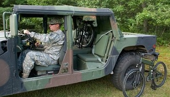 Original Montague Paratrooper folding bikes and a Humvee