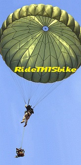 Military paratrooper parachuting with a Montague bike