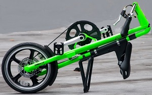 green Strida LT folding bike folded