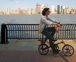 Bicycling along the waterfront on a Strida