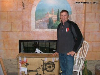 Will Wattles stands beside his boxed up Montague MX folding bike