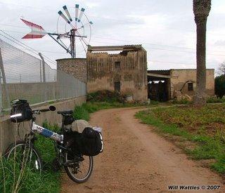 Pannier laden Montague MX full size folding bike near a windmill